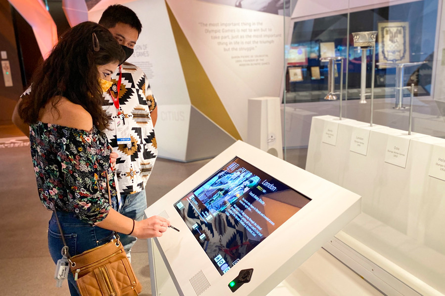 museum visitors using touch screen